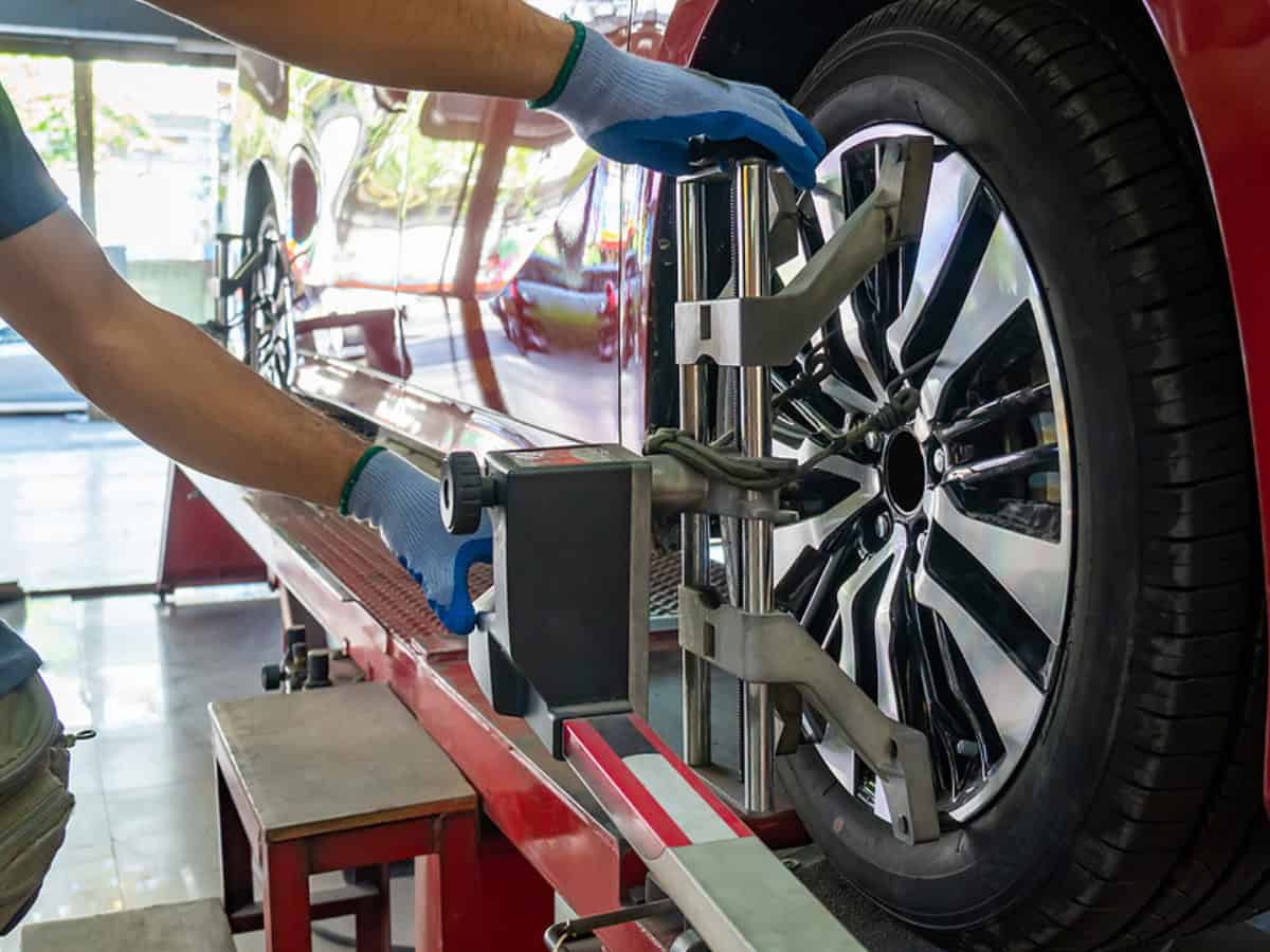Wheel Alignment ,grid Sensor Sets Mechanic On Auto. Car Stand Wi